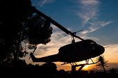 pic of helicopter  - silhouette of a helicopter with sunset background - JPG
