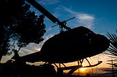foto of helicopter  - silhouette of a helicopter with sunset background - JPG