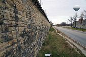 stock photo of illinois  - An exterior limestone wall of the old Illinois State Prison  - JPG