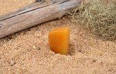 stock photo of calcite  - Colorful and crisp image of orange calcite on beach - JPG
