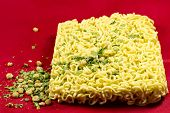 image of noodles  - thisb instant noodles on a red background - JPG