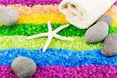 foto of sea salt  - Color sea salt rainbow with sea star stones and bath towel - JPG