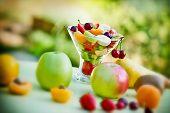 foto of fruit bowl  - Fruit salad of fresh organic fruits in glass bowl - JPG