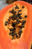 picture of pawpaw  - Slice of ripe orange papaya with pyrenes - JPG