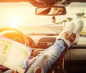 picture of recreational vehicle  - Young woman alone car traveler with map - JPG