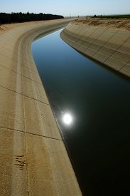 image of water shortage  - The water level is very low in a main irrigation canal in Central California - JPG