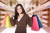 picture of shopping center  - beautiful girl with her shopping bags in a shopping centre - JPG