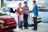 Happy  family buy  new car, car dealer handshaking with daddy congratulated the family on a new car poster
