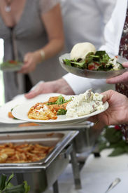 picture of buffet catering  - this is a photo of food being served at a wedding event buffet style - JPG