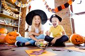 Treat Or Trick! Dessert! Cheerful Amazed Excited Small Kids In Carnival Head Wear, With Colorful Tre poster
