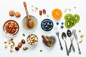 Ingredients For A Healthy Foods Background, Nuts, Honey, Berries, Fruits, Blueberry, Orange, Almonds poster