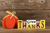 Shabby Chic Give Thanks Wood Sign And Pumpkin Against A Rustic Wooden Background poster