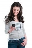 Beautiful smiling young woman holding a smart phone while text messaging isolated on white backgroun