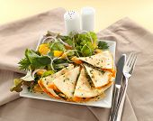 stock photo of healthy food  - Delicious pumpkin quesadilla sliced and ready to serve with a garden salad - JPG