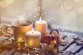 Cup Of Coffee Or Tea Near A Pumpkin And Candles poster