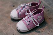 Old baby sneakers closeup photo. horizontal day shot