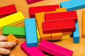 Scattered Heap Of Toy Colored Wooden Bricks poster
