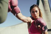 Sportswoman Practicing Boxing Outdoors poster