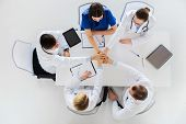 medicine, healthcare and cardiology concept - group of doctors with cardiograms, clipboards and tabl poster