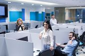 group of young business people with headset working and giving support to customers in a call center poster