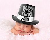 Newborn baby girl wearing a 2018 Happy New Year hat.  poster