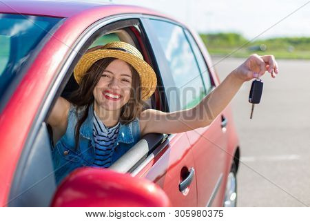 poster of Driver Woman Smiling Showing New Car Keys And Car. Happy Woman Driver Showing Car Keys And Leaning O