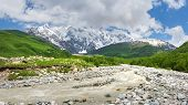 Caucasus Mountains Nature Landscape With Mountain River. Beautiful View On Caucasus Mountains In Geo poster