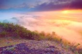 View Over Sharp Peak Of Basalt Formation Into Misty Morning Valley. Long Basalt Poles Of Cold Volcan poster