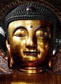 stock photo of siddhartha  - Portrait shot of calm buddah statue - JPG