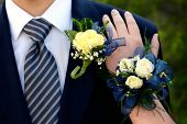Hands of date Prom night flowers corsage formal wear poster
