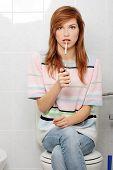 foto of teen smoking  - Teen girl caught on smoking in bathroom - JPG