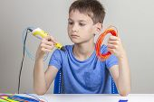 Kid Holding 3d Pen And Colorful Filaments For 3 D Pen And Choose Color For New Item poster