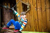 Boy Climbing Up Into A Treehouse. Healthy Games Outdoor. poster
