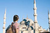 Young Adult Girl Tourist With A Backpack Sightseeing In Istanbul. Tourist Near The Blue Mosque. Tour poster