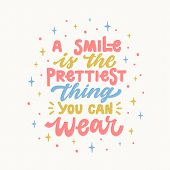 A Smile Is The Prettiest Thing You Can Wear. Iinspirational Hand Drawn Lettering Quote. In Bright Bl poster