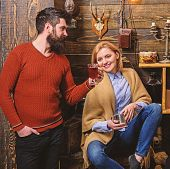 Woman And Man On Smiling Faces Enjoy Cozy Atmosphere With Hot Drinks. Couple Spend Pleasant Evening, poster