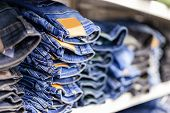 Jeans Clothes Lies Stacked In A Clothes Shop poster