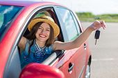 Driver Woman Smiling Showing New Car Keys And Car. Happy Woman Driver Showing Car Keys And Leaning O poster