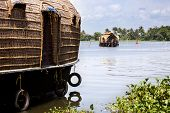stock photo of alleppey  - one backwater arriving at pier in Allepy - JPG