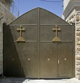 stock photo of crucifiction  - gate entrance to church in Bethlehem west bank Palestine Israel - JPG