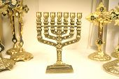 picture of tora  - Golden menorah and other religious symbols on display  - JPG