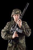 stock photo of m16  - Alerted soldier raised m16 in studio - JPG