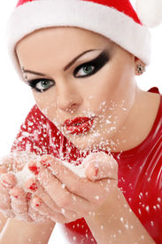 foto of latex woman  - Girl with heavy makeup in Santa hat and latex dress holding snowflakes in cupped hands - JPG