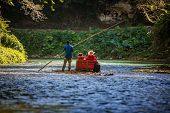 stock photo of martha  - River Boat with tourists on Martha Brae River in Jamaica - JPG