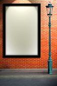 pic of lamp post  - Lamp post street and blank billboard on brick wall - JPG