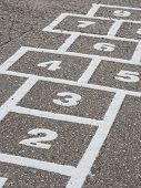 stock photo of hopscotch  - Hopscotch game on cement in school playground - JPG
