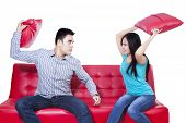Couple Fight On Red Sofa - Isolated
