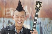 picture of mohawk  - Young man with punk Mohawk holding guitar - JPG