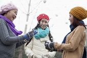 foto of snowball-fight  - Friends Having a Snowball Fight - JPG