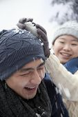 pic of snowball-fight  - Young Couple Having a Snowball Fight - JPG